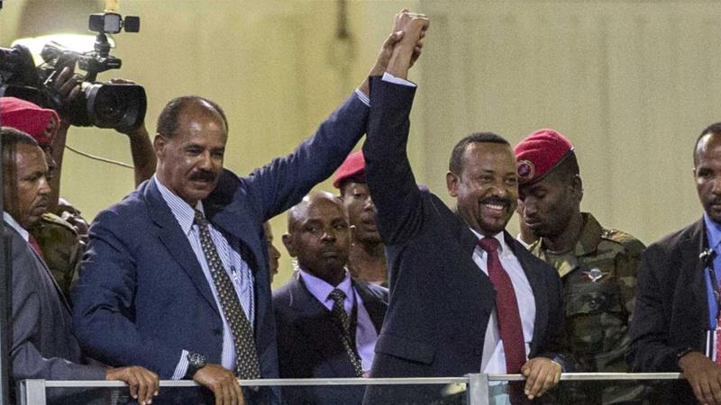 Eritrean President Isaias Afwerki and Ethiopia's Prime Minister Abiy Ahmed hold hands as they wave at the crowds in Addis Ababa, Ethiopia, Sunday July 15, 2018 [Mulugeta Ayene/AP]