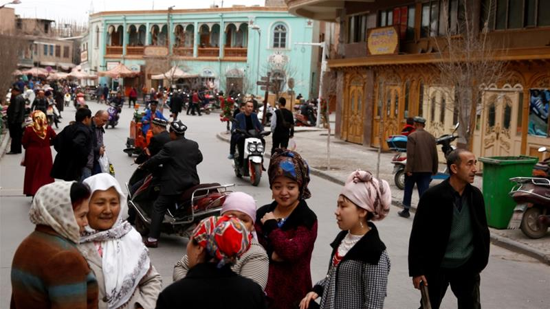People mingle in the old town of Kashgar, Xinjiang Uighur Autonomous Region, China on March 22, 2017 [File: Reuters/Thomas Peter]