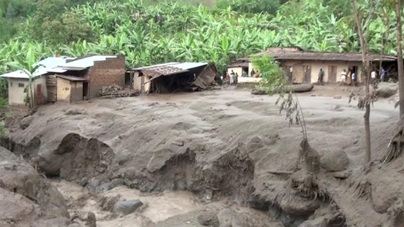 Damaged housing is seen after the landslide triggered by heavy rains in Bududa, Uganda [Reuters TV]