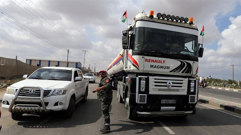 A fuel tanker bound for the Gaza power plant is seen in the central Gaza Strip October 9 [Ibraheem Abu Mustafa/Reuters]