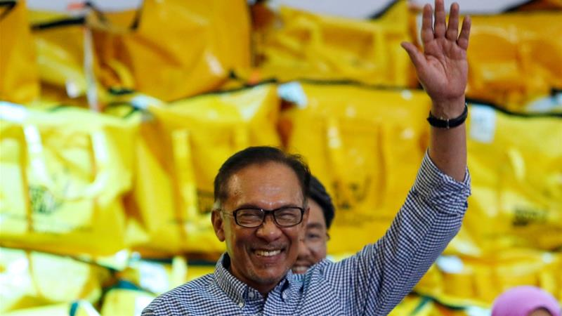 Anwar Ibrahim is expected to be sworn in as a legislator on Monday [Lai Seng Sin/ Reuters]