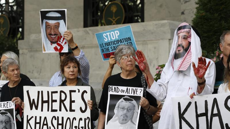 People hold signs at the Embassy of Saudi Arabia during protest about the disappearance of Saudi journalist Jamal Khashoggi, Oct. 10, 2018, in Washington [Jacquelyn Martin/AP]