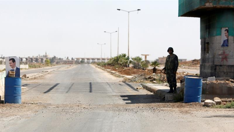 A Syrian soldier stands guard at the Nassib border crossing with Jordan [File:Omar Sanadiki/Reuters]