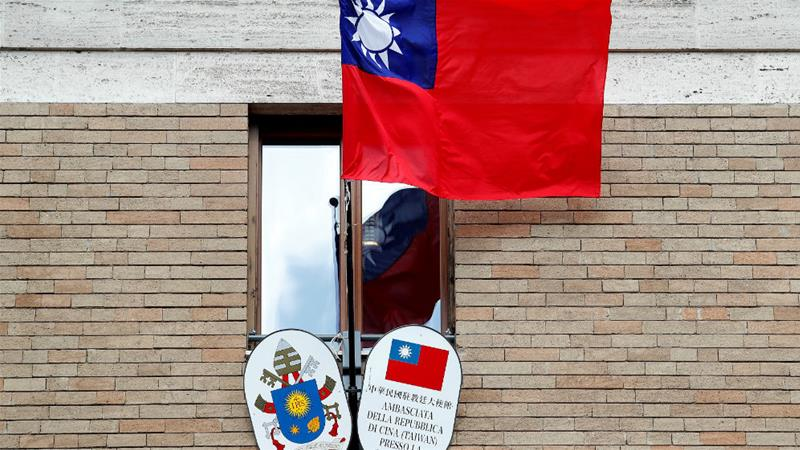Taiwan's flag outside its embassy to the Holy See, the island's last diplomatic ally in Europe [Remo Casilli/Reuters]