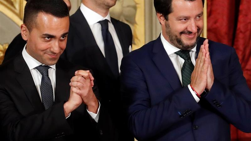 Italy's Minister of Labour and Industry Luigi Di Maio gestures next to Interior Minister Matteo Salvini after the sworn-in ceremony in Rome, Italy, June 1, 2018 [Remo Casilli/Reuters]