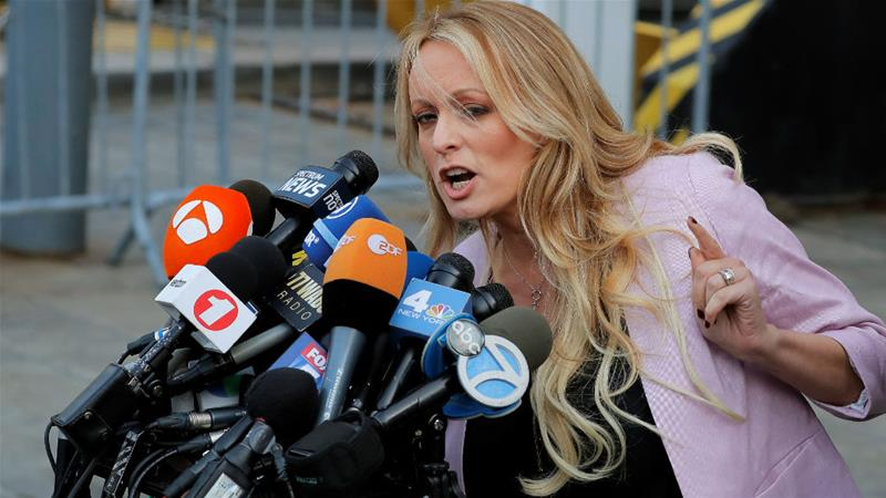 Stormy Daniels speaks to the media after leaving a court in New York City earlier this year [Lucas Jackson/Reuters]