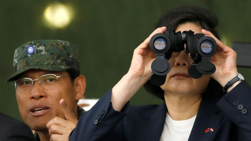 President Tsai Ing-wen looks through a pair of binoculars during an anti-invasion drill last month [Tyrone Siu/Reuters]
