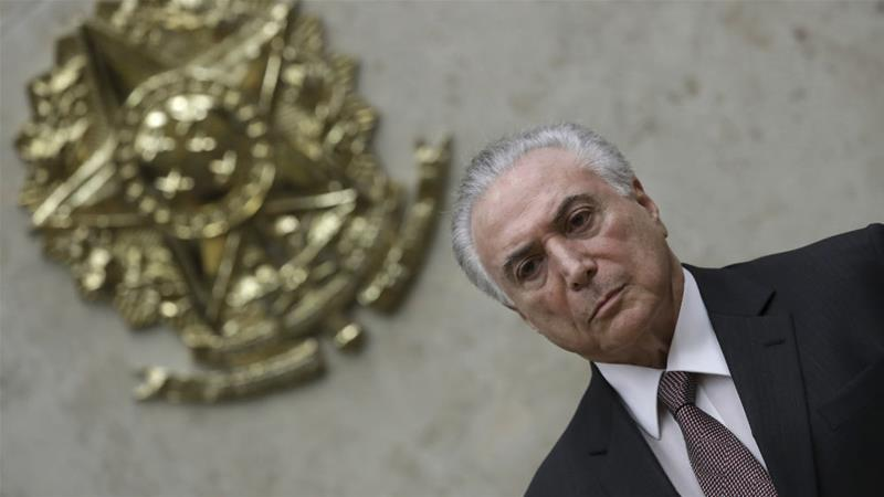 President Michel Temer faces new allegations of corruption along with 10 others [Eraldo Peres/AP]