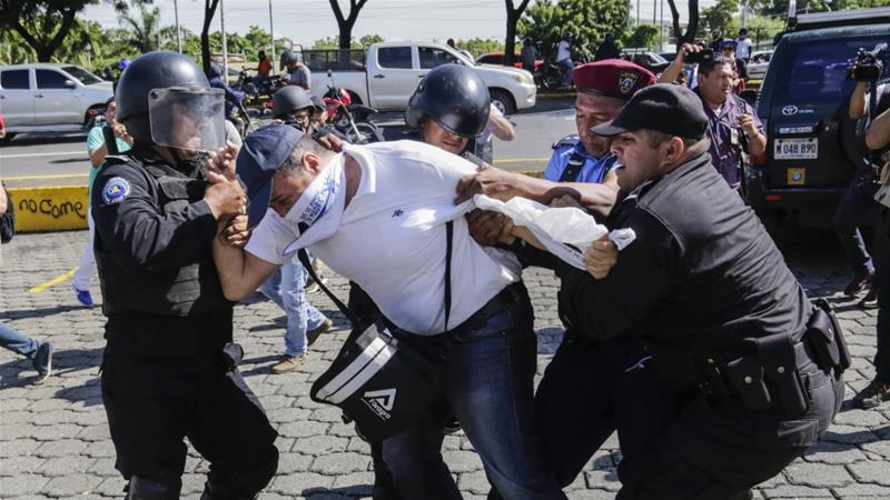 A Nicaraguan man is arrested by riot police during a protest against the government of President Daniel Ortega in Managua [Inti Ocon/AFP]