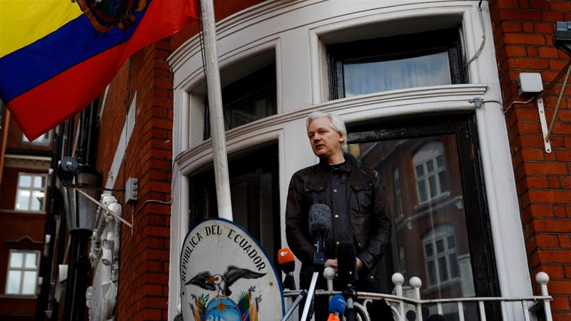 Assange seen on the balcony of the Ecuadorian Embassy in London in 2017 [Peter Nicholls/Reuters]