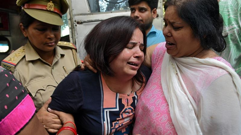 The wife of Vivek Tiwari was consoled by relatives after her husband was shot dead [Reuters]