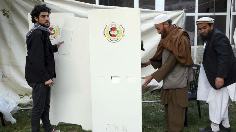 Afghan voters head to the polls amid security threats