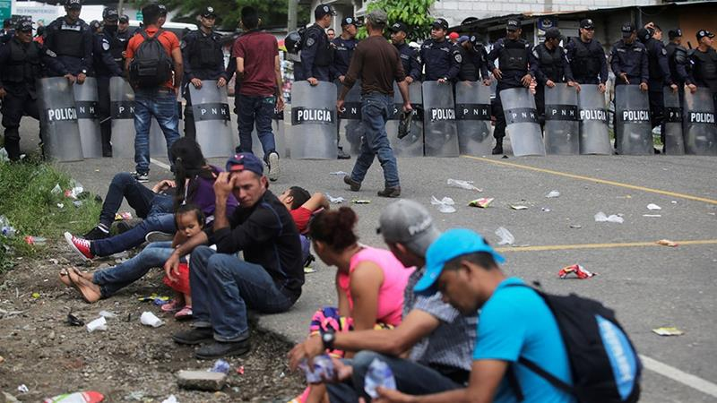 Honduran migrants, part of a caravan trying to reach the US, rest at the border checkpoint between Honduras and Guatemala last week [Jorge Cabrera/Reuters]