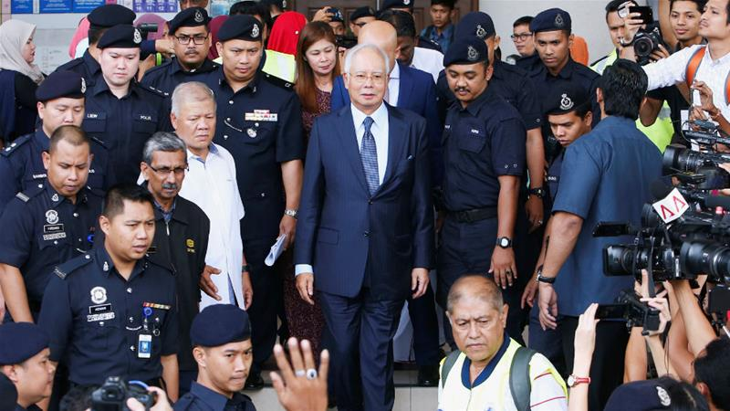 Malaysia's former Prime Minister Najib Razak leaves court in Kuala Lumpur earlier this month [Lai Seng Sin/Reuters]