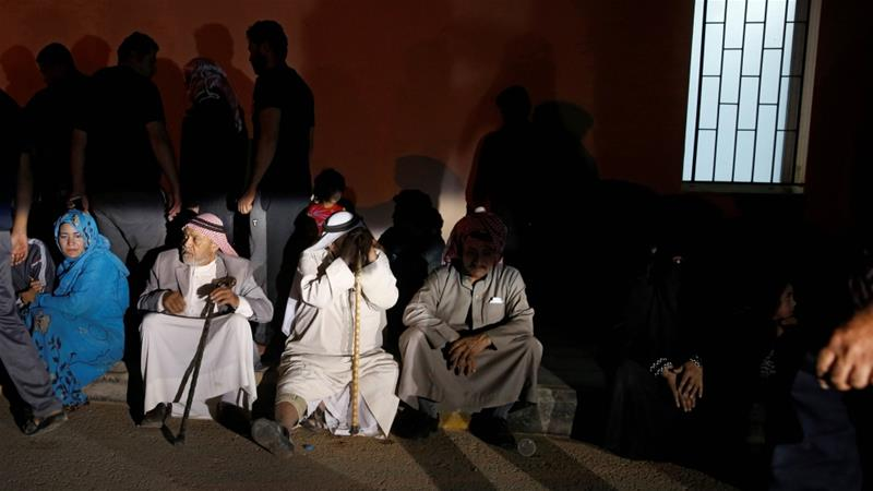 Relatives gather outside a hospital near the Dead Sea, Jordan [Muhammad Hamed/Reuters]