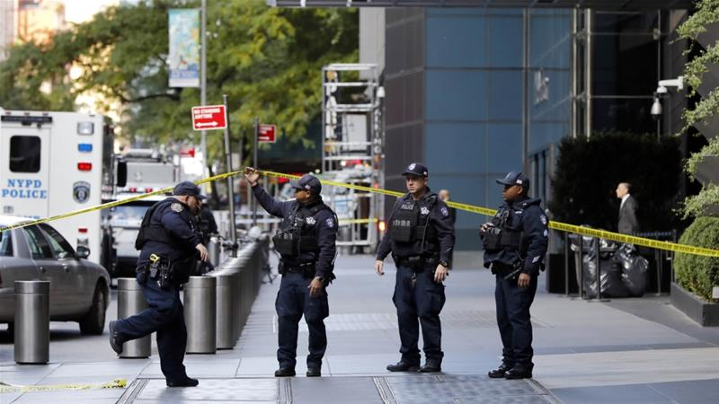 NYPD officers arrive outside the Time Warner Center, in New York after a suspicious package was found in the building's mailroom [Richard Drew/AP Photo]