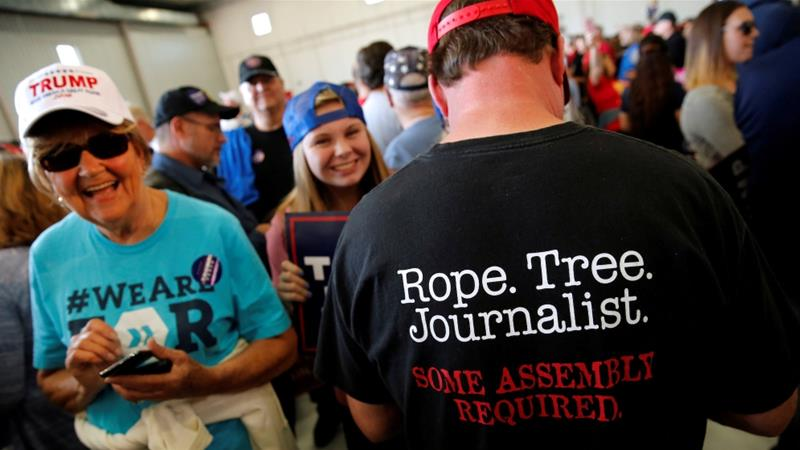 A man wears a shirt reading 'Rope. Tree. Journalist' as supporters gather to rally with then presidential nominee Trump in Minneapolis, Minnesota, US November 6, 2016 [Jonathan Ernst/Reuters]