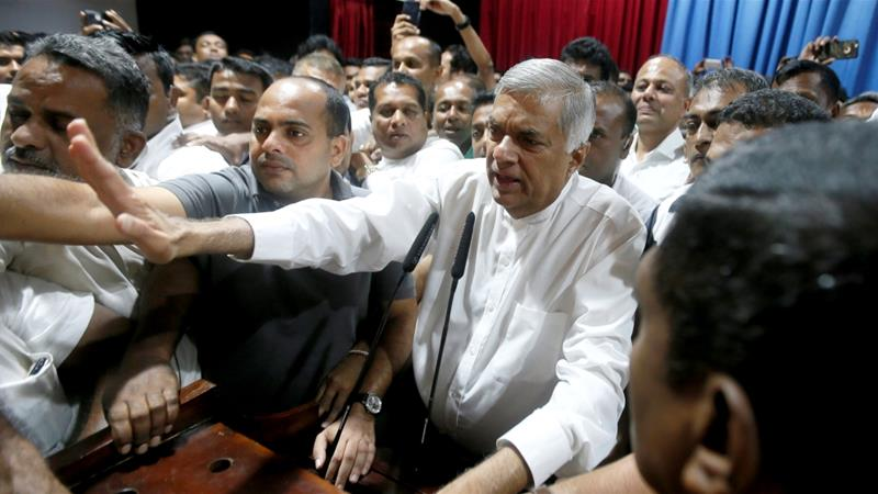Ranil Wickremesinghe (centre) urged the Speaker to convene parliament so he can prove his majority [Dinuka Liyanawatte/Reuters]