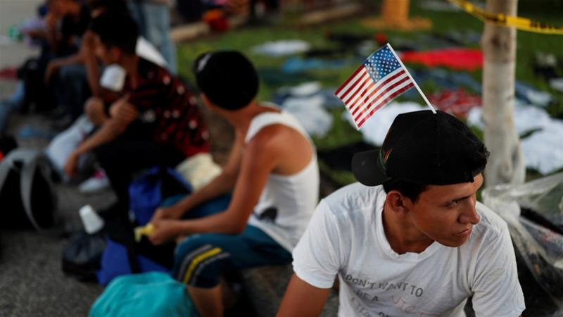 Jose Garcia, a migrant from Honduras en route to the US, rests in a public square as he waits to regroup with more migrants, in Tecun Uman, Guatemala October 25, 2018 [Carlos Garcia Rawlins/Reuters]