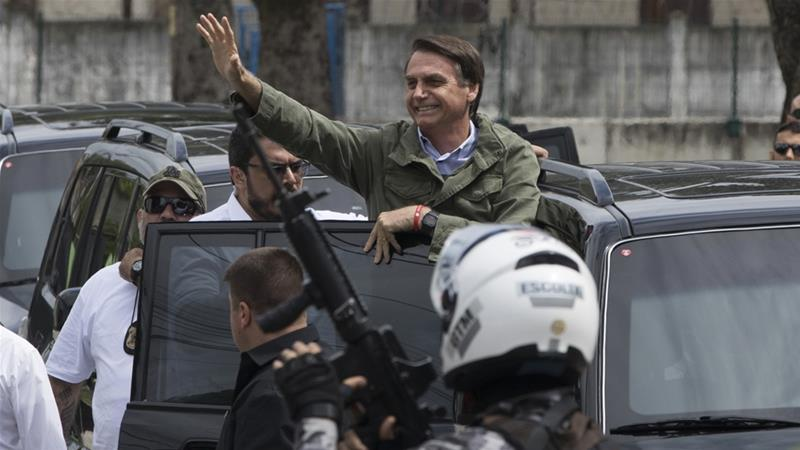 Bolsonaro looks set to win elections in bitterly divided Brazil
