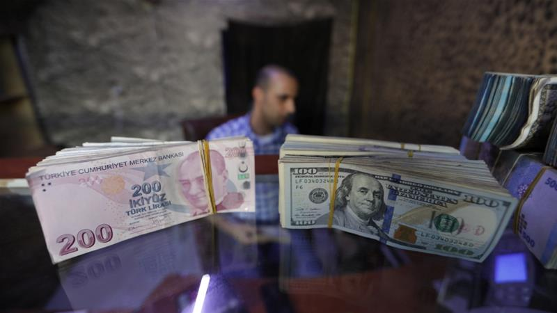 This summer, the Turkish lira lost around half of its value against the US dollar [File: Khalil Ashawi/Reuters]