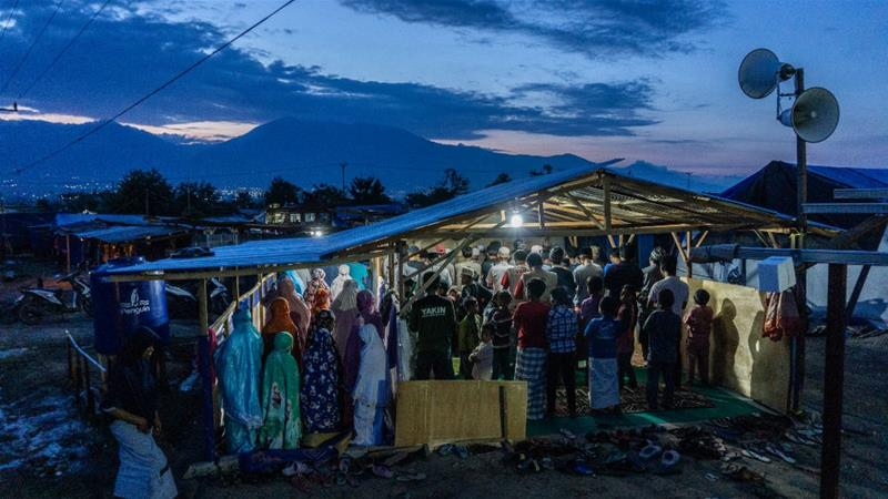 Evening prayers at a temporary mosque in a Red Cross camp in Petobo, a month after the Sulawesi disaster [Ian Morse/Al Jazeera]