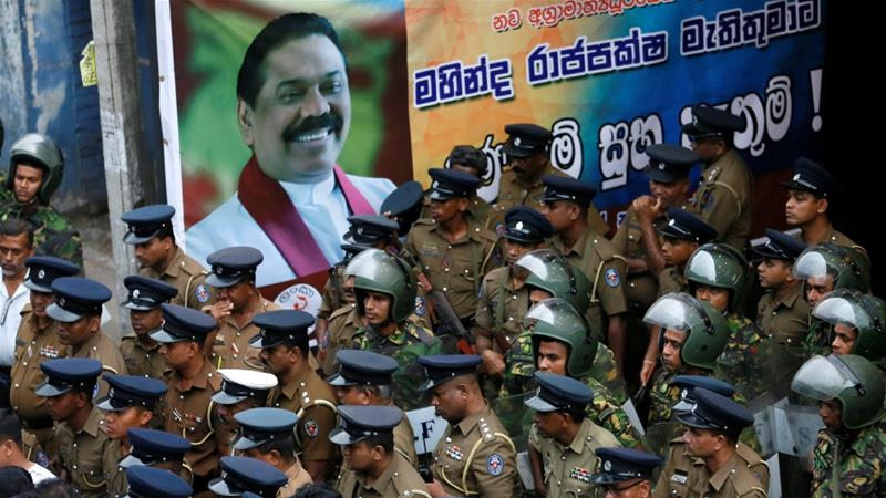Sacked minister arrested after his bodyguard shot live rounds at a crowd in Colombo [File: Dinuka Liyanawatte/Reuters]