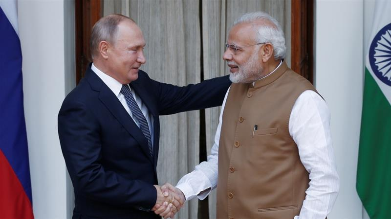 Putin shakes hands with Modi ahead of their meeting at Hyderabad House in New Delhi [Adnan Abidi/Reuters]