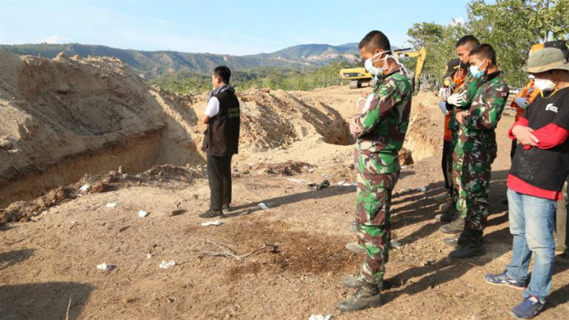 The site of a mass grave near Palu where hundreds have been buried over the past week [Ted Regencia/Al Jazeera]