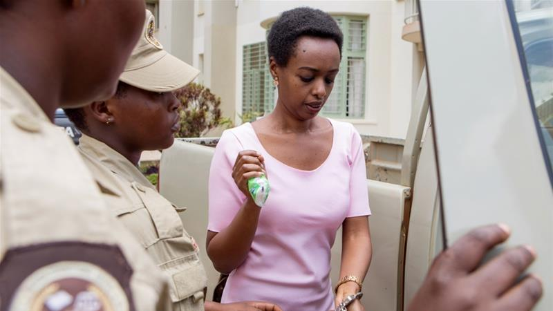 Diane Rwigara, a prominent critic of Rwanda''s president Paul Kagame, is handcuffed as she arrives at the courtroom in Kigali [Jean Bizimana/Reuters]