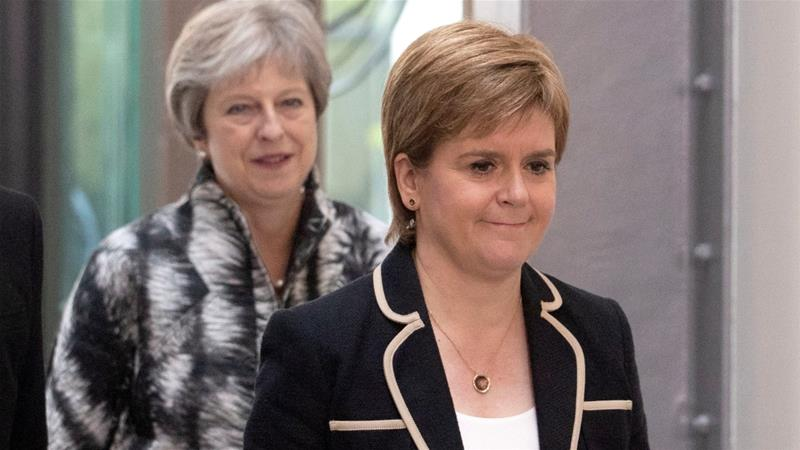 Britain's PM Theresa May and Scotland's First Minister Nicola Sturgeon arrive at the University of Edinburgh before signing the Edinburgh and South East Scotland City Region Deal on August 7 [Reuters]