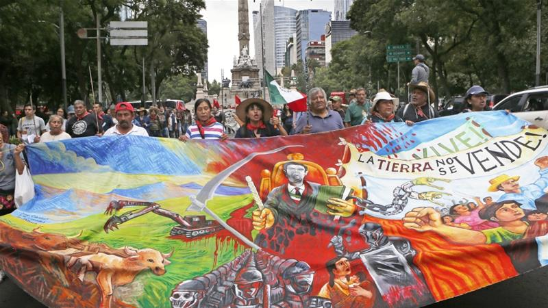 Residents who live in Atenco march against the construction of a new airport near their community in Mexico City on August 23, 2018 [AP Photo/Marco Ugarte]
