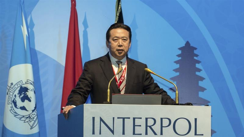 China's former Interpol chief pleads guilty to bribery