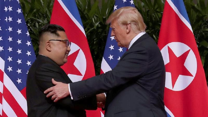 President Donald Trump shakes hands with North Korean leader Kim Jong Un in Singapore in June