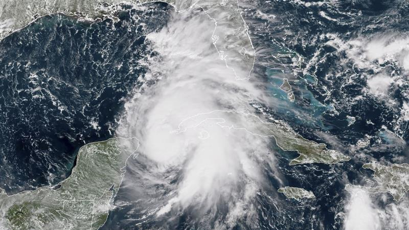 The hurricane may be the most powerful to strike the Florida Panhandle in at least a decade [File: NOAA/RAMMB/AFP]