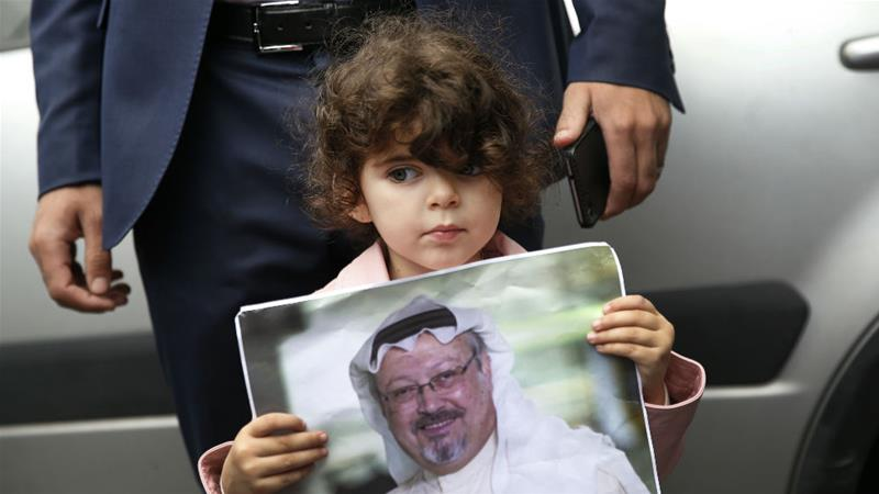 A girl holds a poster with a photo of missing Saudi writer Jamal Khashoggi during a protest [Lefteris Pitarakis/AP]