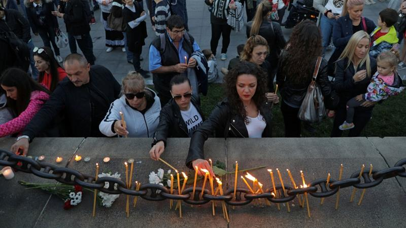 People in Ruse have observed a vigil and laid flowers and lit candles in memory of Marinova [Stoyan Nenov/Reuters]