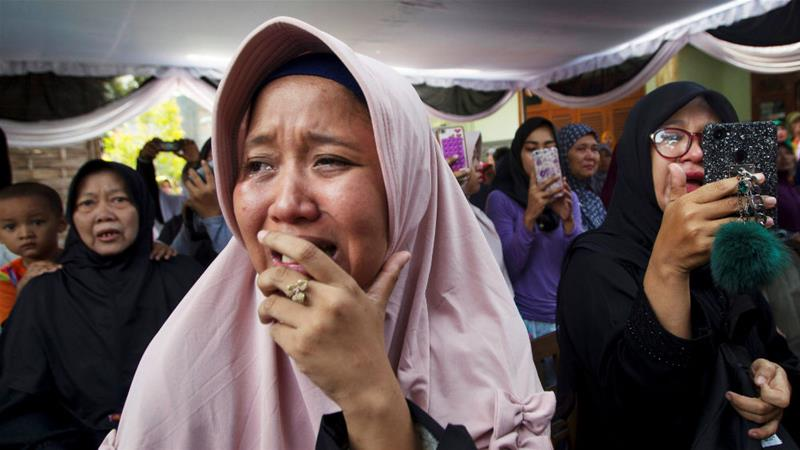 A victim's family member cries at a funeral in Sidoarjo, Indonesia, on Thursday [Sigit Pamungkas/Reuters]