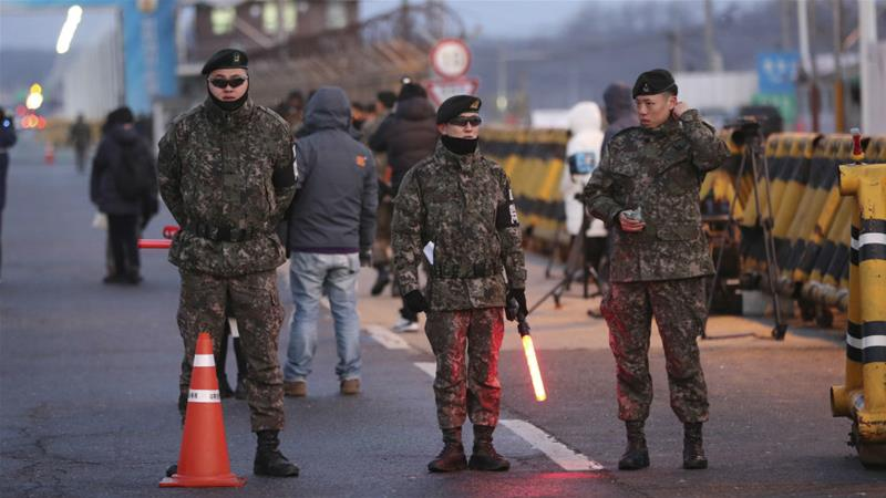 South Korean soldiers stand guard on a road leading to Panmunjom in the Demilitarised Zone [Lee Jin-man/AP]
