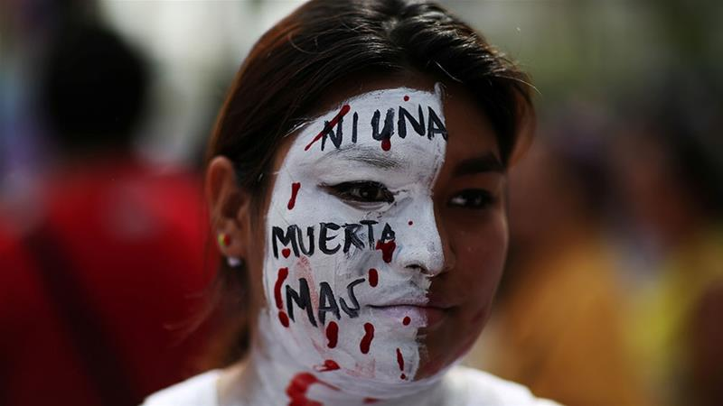 A woman participates in a demonstration to ask for decriminalisation of abortion in San Salvador [File: Jose Cabezas/Reuters]