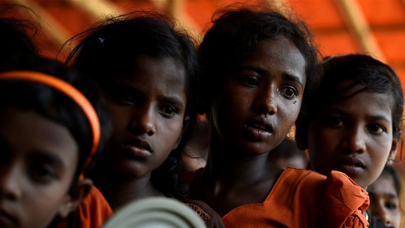 Young Rohingya women queue for food at Jamtoli refugee camp in Bangladesh in June [Clodagh Kilocyne/Reuters]
