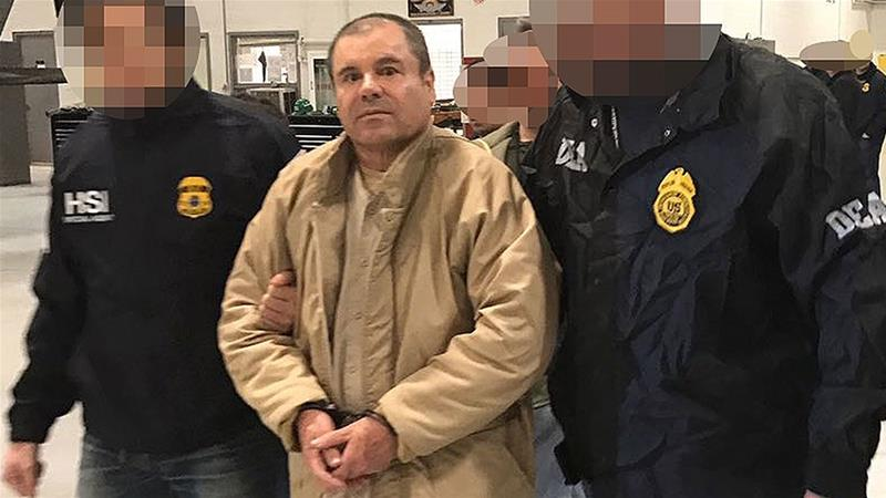 This handout picture released by the Mexican Interior Ministry shows Joaquin Guzman Loera aka 'El Chapo' Guzman escorted in Ciudad Juarez by the Mexican police as he is extradited to the United States [File: Handout/Interior Ministry of Mexico/AFP]