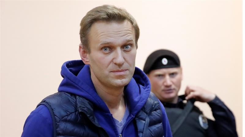 Russian opposition leader Alexei Navalny in a court hearing after his arrest in in September [Maxim Shemetov/Reuters]