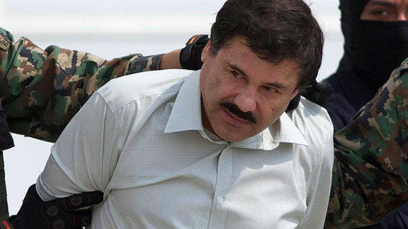 Joaquin ''El Chapo'' Guzman, the head of Mexico's Sinaloa Cartel, is escorted to a helicopter in Mexico City following his capture overnight in the beach resort town of Mazatlan  [File: Eduardo Verdugo/AP Photo]