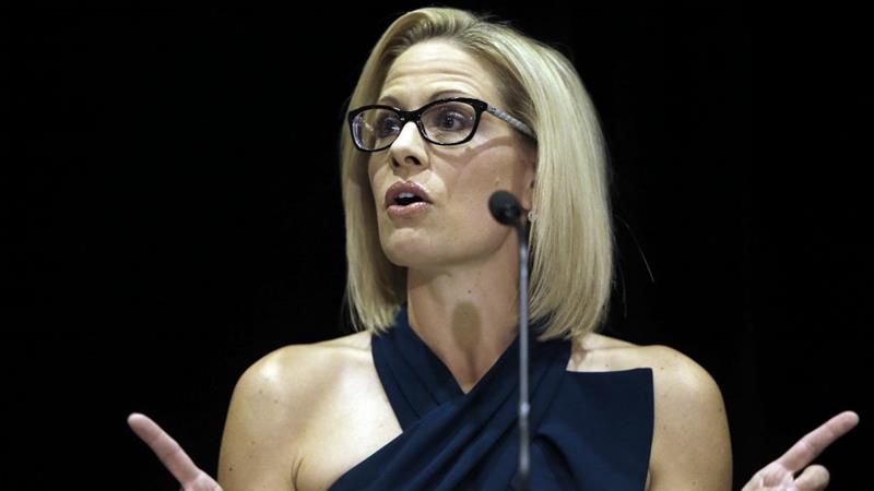 Kyrsten Sinema speaks after being declared winner over Republican challenger Martha McSally on Monday [Rick Scuteri/AP]