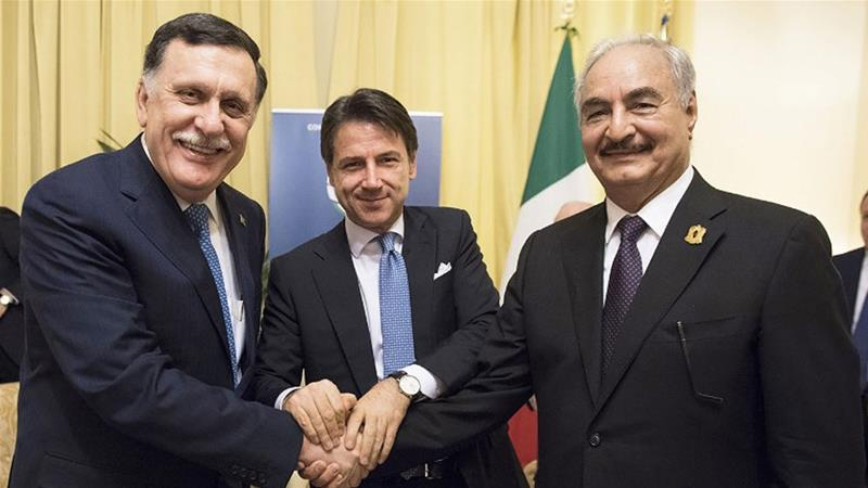Conte (centre) flanked by al-Serraj (left) and Haftar (right) [Filippo Attili/AFP]