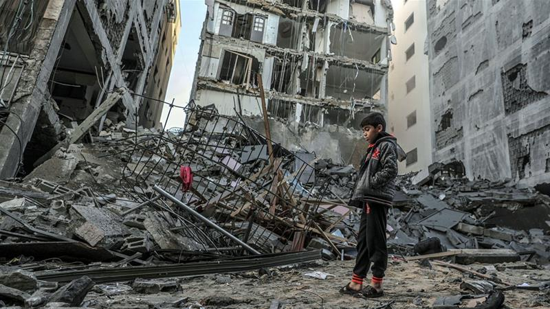 A Palestinian boy inspects the rubble of a destroyed residential building after an Israeli air attack in Gaza City in November [Mohammed Saber/EPA-EFE]