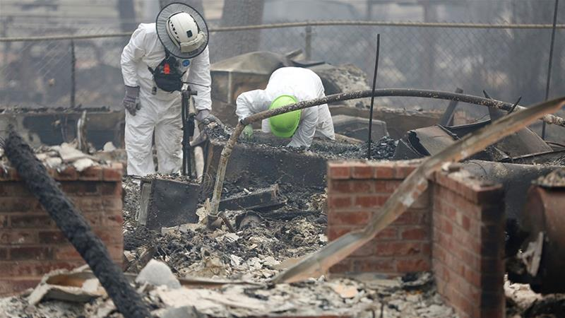 Donald Trump surveys California fire damage with Gavin Newsom