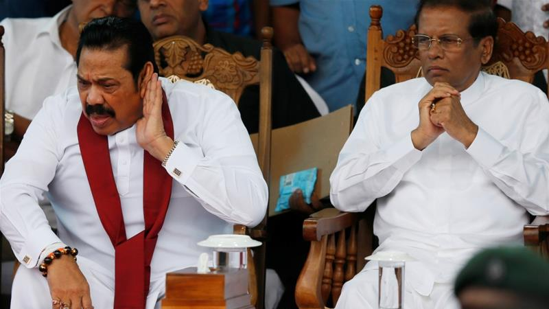 Sri Lanka was plunged into crisis when Sirisena (right) replaced PM Wickremesinghe with Rajapaksa (left) [File: Dinuka Liyanawatte/ Reuters]