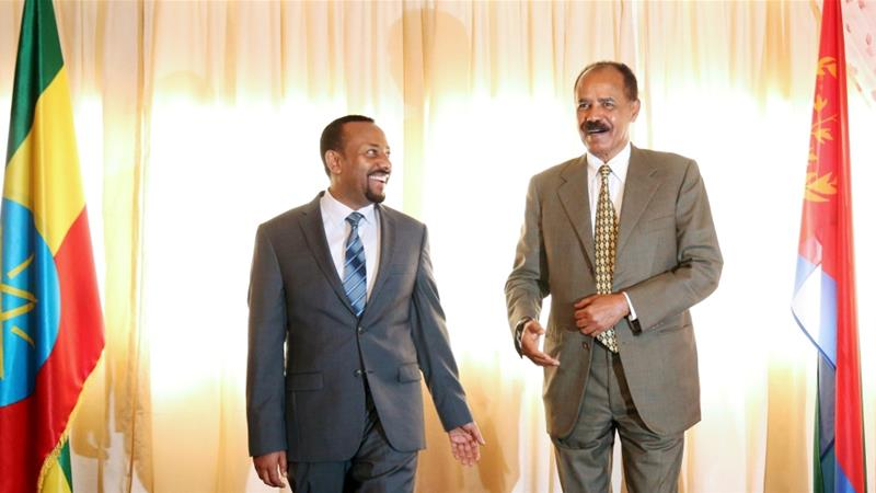 Eritrea's President Isaias Afwerki talks to Ethiopia's Prime Minister Abiy Ahmed during the ceremony marking the reopening of the Eritrean Embassy in Addis Ababa on July 16, 2018 [File: Reuters]